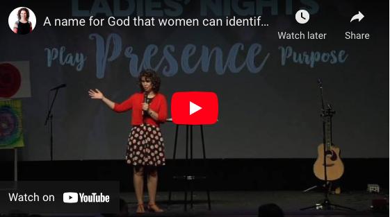 woman on stage gesturing